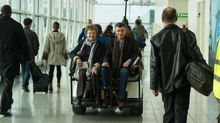 Dame Judi Dench and Steve Coogan filming Philomena at Stansted Airport last year.