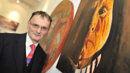 Anthony Wooding with some of the work that he is exhibiting in Ipswich Town Hall