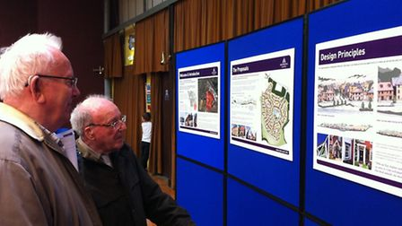 Residents examine the proposals for up to 300 new homes in Needham Market called the Lake Park devel