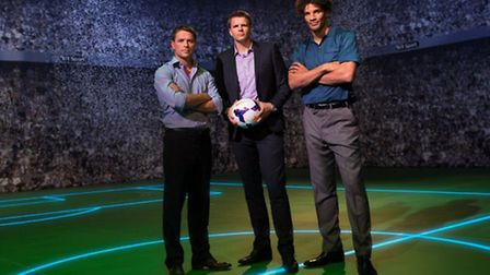 Jake Humphrey, host of BT's Premier League football coverage, on set with pundits Michael Owen and D