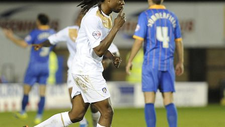 Marcus Bean celebrates his equaliser for Colchester during the first half at Shrewsbury