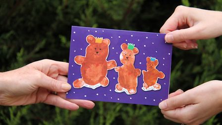 The Christmas card which is being sold by EACH.
