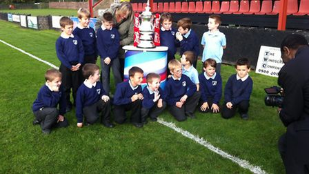 Bosmere Community Primary School pupils with the FA Cup at Bloomfields
