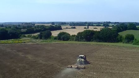 A tractor busy working on a field in Suffolk