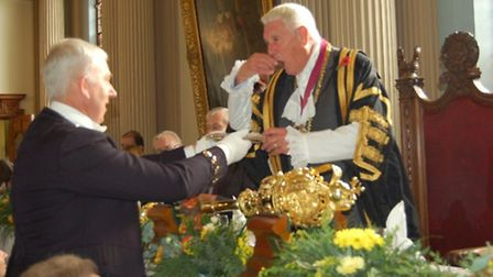 Colchester Mayor Colin Sykes samples and oyster handed to him by Town Serjeant Michael Kirby at the