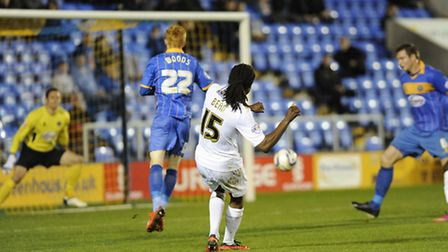 Marcus Bean curls in the equaliser for Colchester during the first half at Shrewsbury