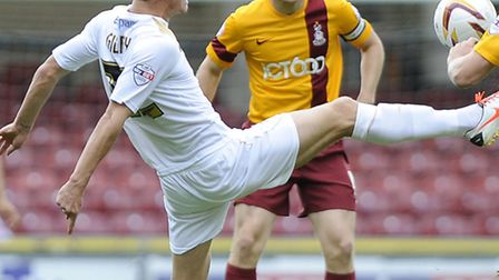 Alex Gilbey stretches for the ball early on against Bradford at Valley Parade