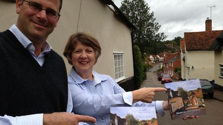 Alex Paul and Margaret Hinkins with the new brochure