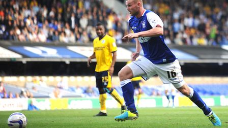 Ryan Tunnicliffe in action for Ipswich Town.