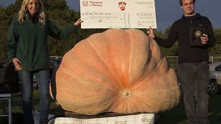 Mark Bagg and his winning 1,520lb pumpkin is handed his prize by Thompson & Morgan's Sarah Curtis. P