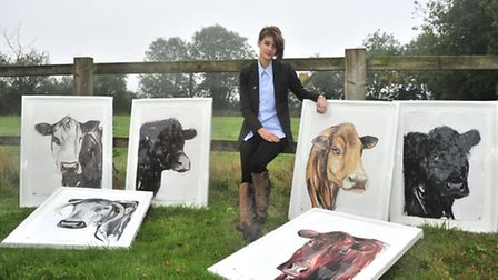 Sophie Elinor Martin of Clopton with her drawing of British Cows for Martin Blackwell of Direct Meat