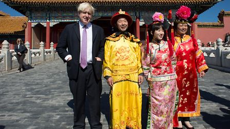 London Mayor Boris Johnson meets tourists as he tours the Forbidden City in Beijing. The Mayor is on