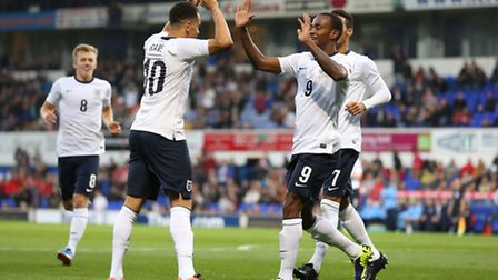 Ravel Morrison (centre left) celebrates with Saido Berahino after scoring in England Under-21s 5-0 w
