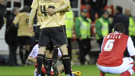 Joy & Pain: Elliott Lee is congratulated at Rotherham after the final whistle