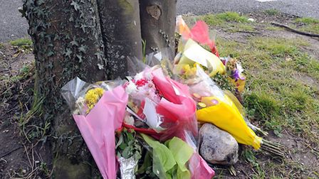 Floral tributes for Mary Roberts who was found in the car park of the St Edmunds Tavern in Bury St E