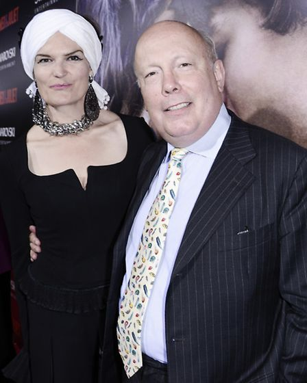 Writer Julian Fellowes, right, and his wife Emma Joy Kitchener arrive on the red carpet at the premi