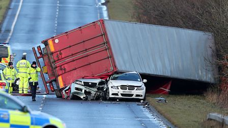 The scene where a lorry driver has died as his HGV toppled on to a number of cars on the A801 in Wes