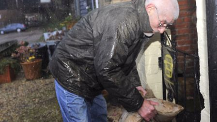 Clive Saxby has used sandbags to protect his home on Mistley Quay along with helping his neighbors.