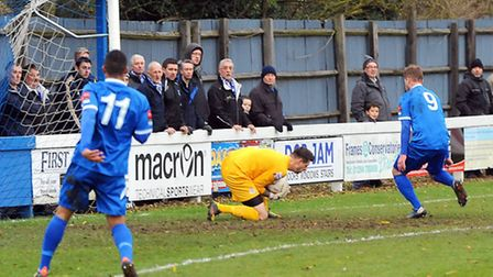 Bury Town v Eastleigh. FA Trophy First Round.Ross Flitney saves Shane Tolley's strike.