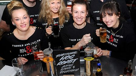 A three-day beer festival taking place at Wickham Market Village Hall. Bar staff and organisers with