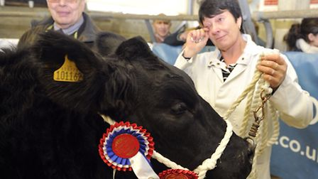 Heather Blythe tears up after her heifer took first place at the Colchester cattle market as she was