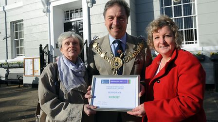L-R: Jan Osborne, Adrian Osborne and Jacqui Howells are pictured with an award for work with young p