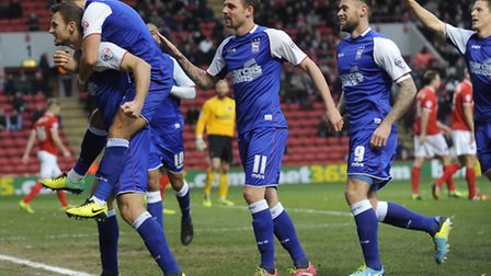 Tommy Smith celebrates with his team-mates after scoring at Charlton.