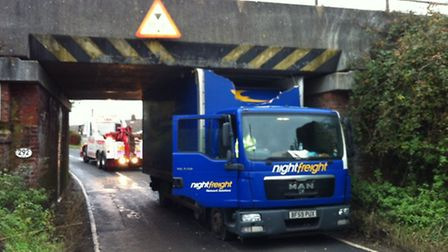 A lorry has become stuck under a railway bridge at Bacton