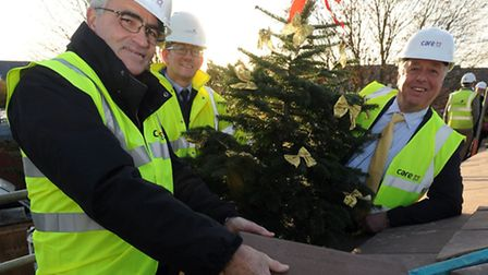 The topping out ceremony at Davers Court care home in Bury. L-R: Cllr Alan Murray, Dean Richardson (
