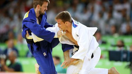 Great Britain's Colin Oates (left) during his 66kg bout against France's Killian le Blouch in the R