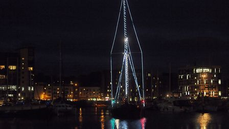 Father Christmas arrives at Ipswich Waterfront on an historic barge.