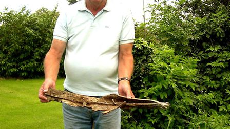 Mick Muttitt, of Blythburgh, on 2004, with a piece of wreckage from the stricken aircraft being pilo