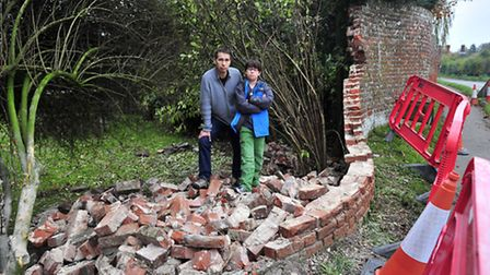 Ian Palfreyman and Myles McEvoy with what remains of their 200 year old Crickle Crangle wall in East