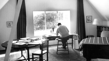 Benjamin Britten at work in his studio at The Red House.
