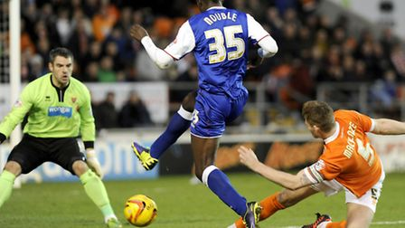 Gary Mackenzie makes a last ditch challenge to deny Frank Nouble during the second half at Blackpool