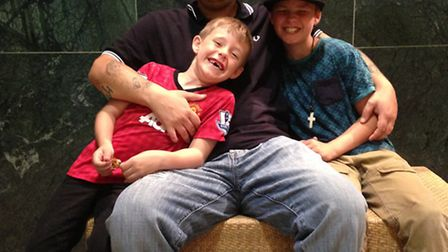 Russell Harris with his sons Ronnie, 10, and Lennie, 6.