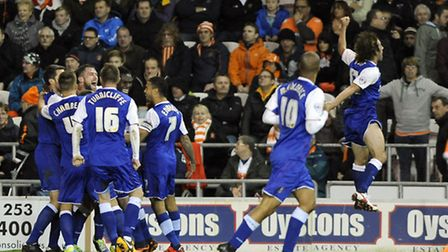 Stephen Hunt (far right) celebrates wildly following Ipswich Town's dramatic 3-2 win at Blackpool