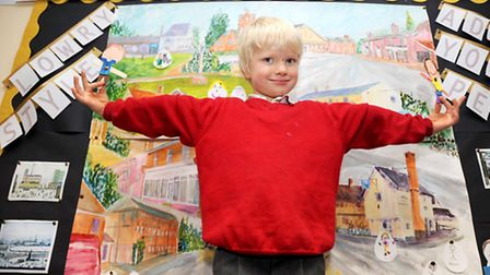 Kids creating a 'Lowry' type scene of their street in Glemsford Library. Pictured is Otto Norris.