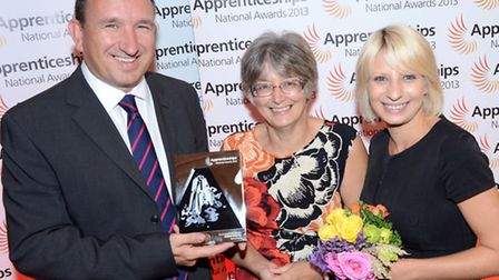 Guest speaker Yvonne Carter of FCO Services, centre, presents the Macro Employer of the Year award t