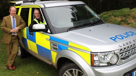Police and crime commissioner Tim Passmore and Pc Mark Bryant with the new Land Rover