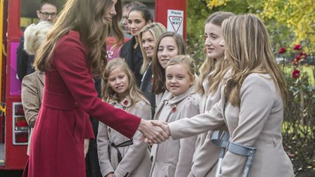 Suffolk singer Laura Wright has been mentoring the Poppy Girls - together they met Kate Middleton an