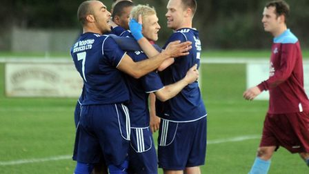 Destined for success? Hadleigh United celebrate.