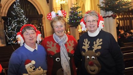 Jenny Buckle, Sylvia Pearce and Marion McKinley dressed festively for the annual Concert of Carols o