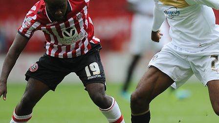 Sanchez Watt, in action against Sheffield United, is pushing for a start at MK Dons today