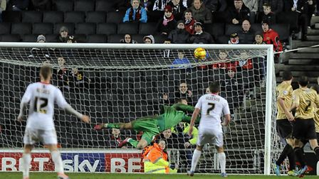 Colchester keeper Sam Walker makes a great reaction save to keep the U's in the game at MK Dons