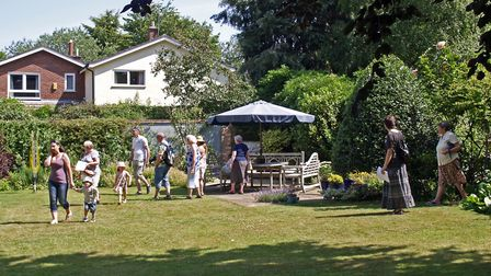 Visitors enjoy a garden in London Road as part of a previous Harleston Open Gardens. Picture: ARCHAN