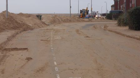 Sand being cleared away in Hastings Avenue, Clacton