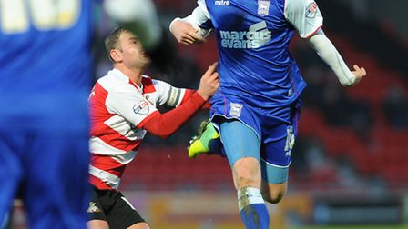 Ryan Tunnicliffe wins a midfield ball at Doncaster