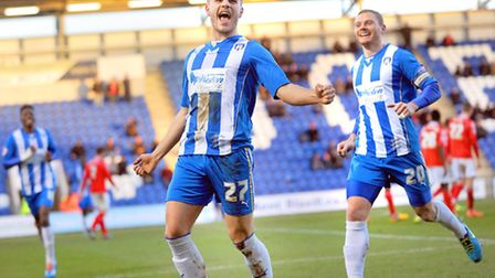 Luke Garbutt celebrates after his goal against Crewe this afternoon, although the U's eventually los