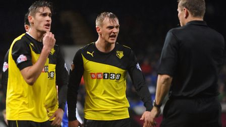 Watford players remonstrate with the referee following his award of an Ipswich Town penalty. PHOTO: